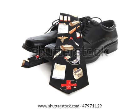 A business man's shoes and a doctor theme tie over white background - stock photo