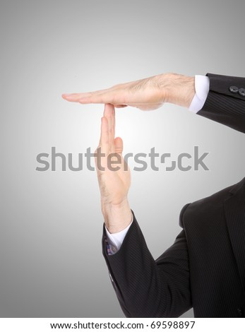 A business man signaling time-out with hands - stock photo