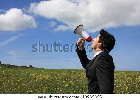 A business man speaking to god with a megaphone