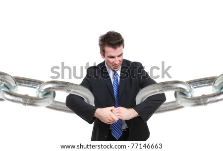 A business man struggling to make a connection with chain links - stock photo