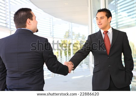 A business man team handshake at office building - stock photo