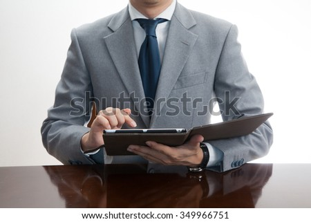 A business man using iPad - stock photo