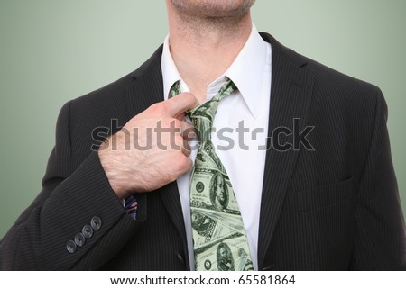 A business man with a conceptual money themed tie - stock photo