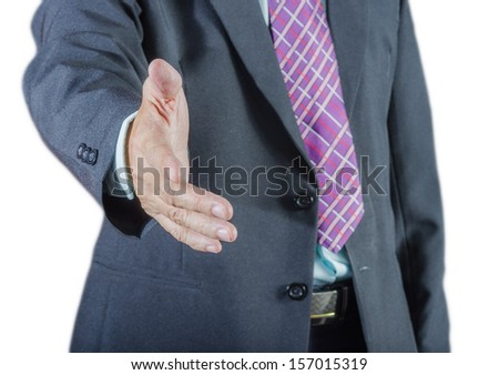 A business man with an open hand ready to seal a deal,isolated on white background - stock photo