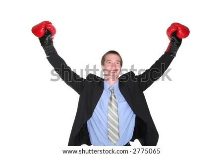 A business man with boxing gloves celebrating his success