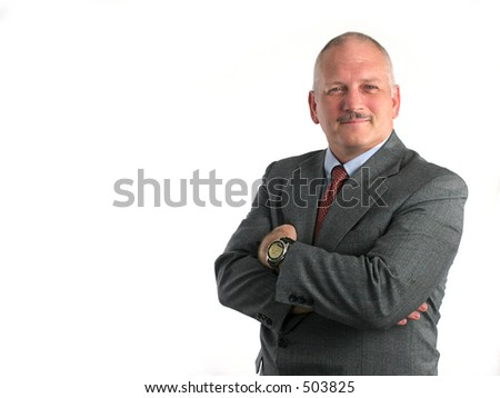 a business man with his arms crossed looking confident and self-assured (room for text)