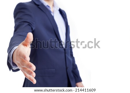 A business man with open hand for handshake, isolated on white - stock photo