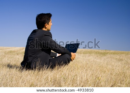 a business man working in and with the nature - stock photo