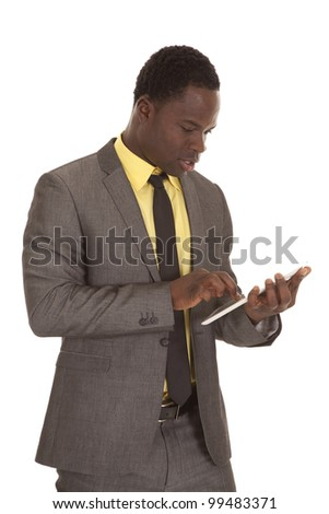 a business man working on his computer tablet. - stock photo