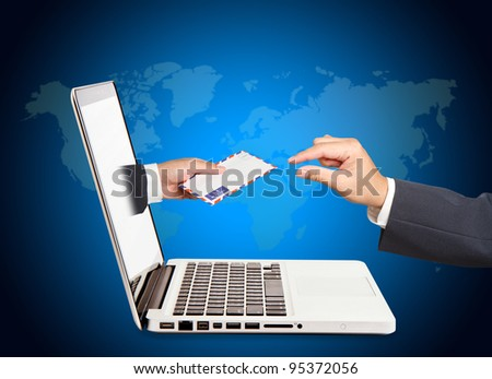 A business people hand holding air mail with  hand concept of receiving a message through a laptop - stock photo