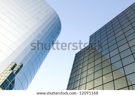 A business skyrise with reflective glass in a business district