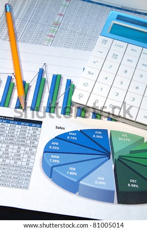 A business strategy using color charts and a calculator - stock photo