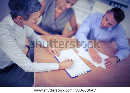 A business team brainstorming together in the office - stock photo