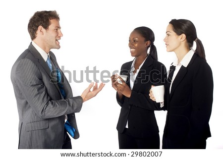 A business team breaking for coffee - stock photo