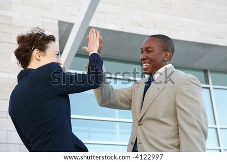 A business team celebrating a success outside the office - stock photo