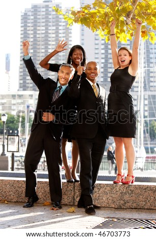 A business team celebrating success - stock photo