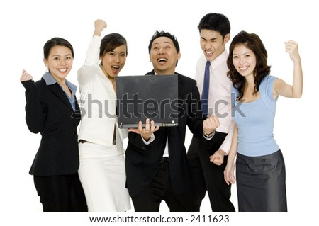 A business team find out some good news on their laptop