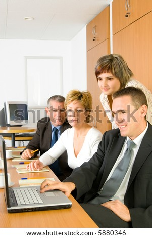 A business team, group with laptop discussing in the conference room.