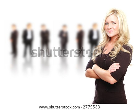 a business team lead by a business woman - stock photo