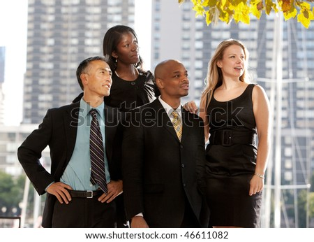 A business team looking to the side or into the distance - stock photo