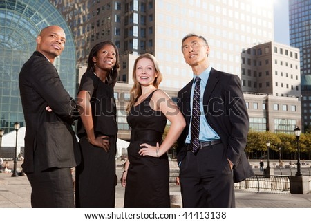 A business team looking up into the future - stock photo
