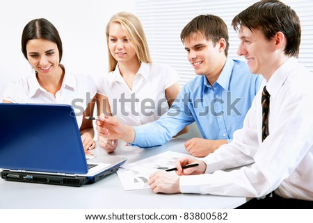 A business team of four planning work in office