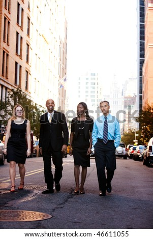 A business team outside on a street in a city