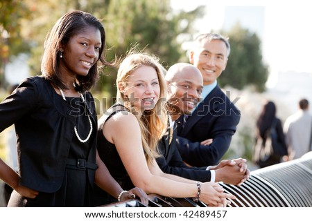 A business team outside - sharp focus on front woman