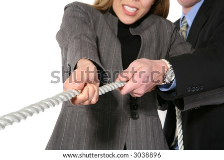 A business team playing tug of war in an intense stRuggle - stock photo