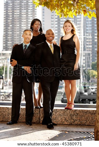 A business team portrait in an outdoor setting