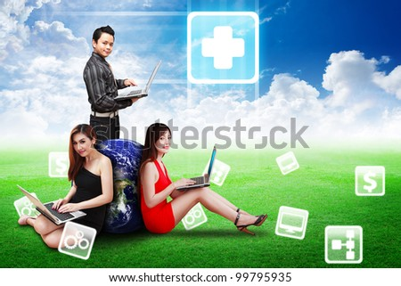 A Business team present the First Aid icon on the sky and grass field : Elements of this image furnished by NASA