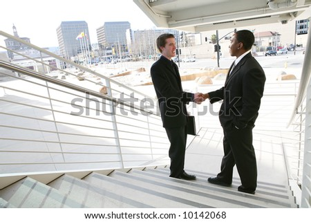A business team shaking hands in agreement - stock photo