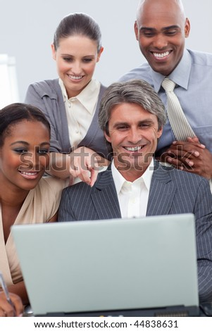 A business team showing ethnic diversity using a laptop in a meeting
