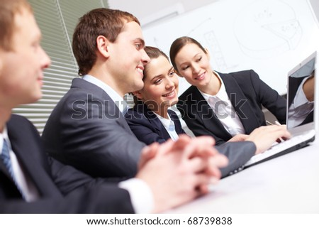 A business team sitting in the office and communicating - stock photo