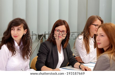 A business team sitting on a meeting - stock photo