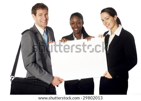 A business team with a blank sign - stock photo