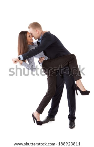 A business woman and man dance