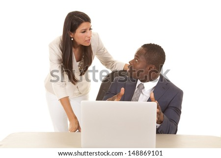 A business woman and man discussing things on the computer. - stock photo
