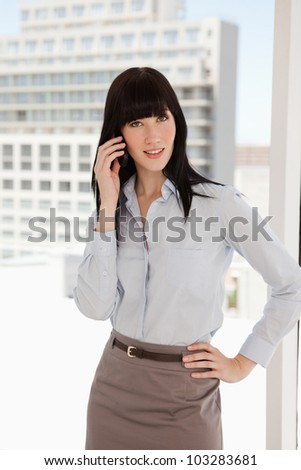 A business woman at work taking a phone call - stock photo