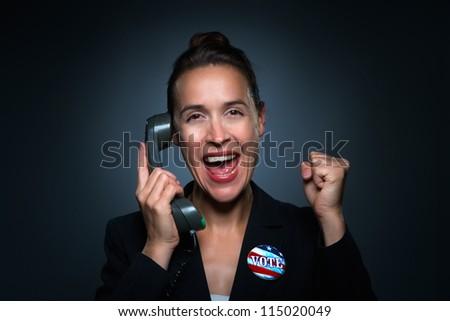A business woman charcterizing winning an election. - stock photo