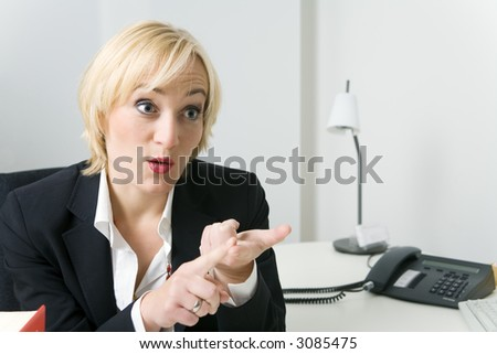 a business woman counting or giving arguments