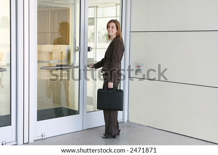 A business woman entering company to start work - stock photo