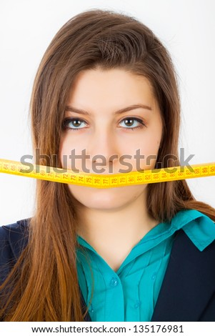 A business woman has a tape around her mouth - stock photo