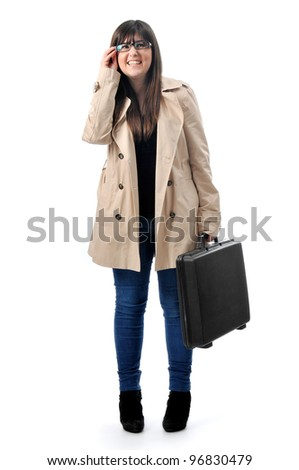 a business woman holds a briefcase - stock photo