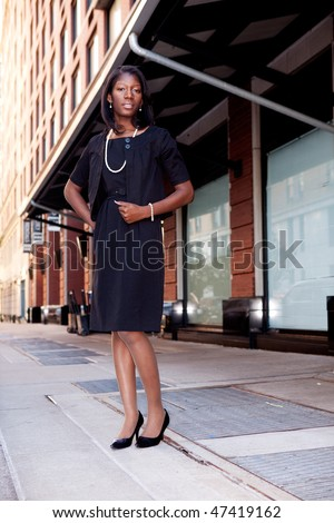 A business woman in a natural street setting - stock photo