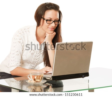 A business woman is drinking tea at the desk - on white background - stock photo