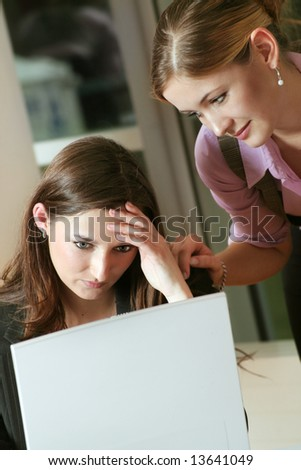 a business woman is frustrated on a table with a laptop - stock photo