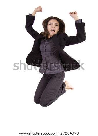 A business woman is jumping in pure celebration