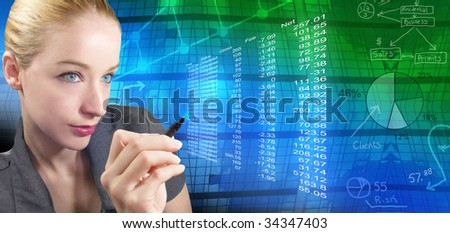 A business woman is reviewing financial figures and there is an abstract background with charts and graphs behind her. She is holding a pen. - stock photo