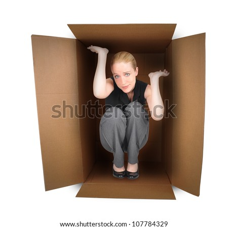 A business woman is trapped in a small box with anxiety on a white background. Use it for a employment or pressure metaphor. - stock photo